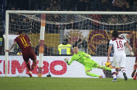 Roma's Aleksandar Kolarov, left, scores a goal from a penalty against Bologna, during Italian Serie A soccer match between AS Roma and Bologna FC at Olimpico stadium in Rome, Italy, on Feb. 18, 2019. (Maurizio Brambatti/ANSA via AP)