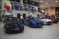 Toyota sedans are displayed in a showroom at Puente Hills Toyota on Feb. 14, 2019, in Industry, Calif. (AP Photo/Jae C. Hong)