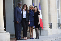 Brigitte Macron, wife of French President Emmanuel Macron, second from right, Nobel Peace Prize laureates Dr. Denis Mukwege from Congo, left, and Nadia Murad from Iraq, right, pose with French Secretary of State for women's rights Marlene Schiappa before a meeting of gender equality ahead of the upcoming G7, on Feb.19, 2019 at the Elysee Palace in Paris. (AP Photo/Francois Mori)