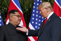 In this June 12, 2018 file photo, U.S. President Donald Trump, right, meets with North Korean leader Kim Jong Un on Sentosa Island in Singapore. (AP Photo/Evan Vucci)
