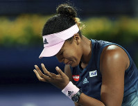 Naomi Osaka, of Japan, reacts during her match against Kristina Mladenovic, of France, at the Dubai Duty Free Tennis Championship in Dubai, United Arab Emirates, on Feb. 19, 2019. (AP Photo/Kamran Jebreili)