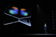 DJ Koh, Samsung President and CEO of IT and Mobile Communications, talks about the new Samsung Galaxy Fold smartphone during an event on Feb. 20, 2019, in San Francisco. (AP Photo/Eric Risberg)