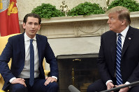 President Donald Trump, right, listens as Austrian Chancellor Sebastian Kurz, left, speaks during their meeting in the Oval Office of the White House in Washington, on  Feb. 20, 2019. (AP Photo/Susan Walsh)