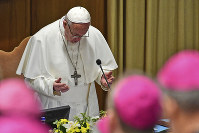 Pope Francis prays at the opening of a sex abuse prevention summit, at the Vatican, on Feb. 21, 2019. (Vincenzo Pinto/Pool Photo via AP)