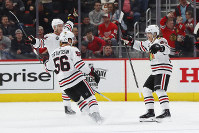 Chicago Blackhawks right wing Patrick Kane, right, celebrates his goal in overtime of an NHL hockey game against the Detroit Red Wings, on Feb. 20, 2019, in Detroit. (AP Photo/Paul Sancya)