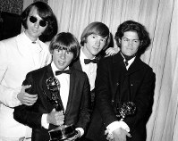 This June 4, 1967 file photo shows, from left, Mike Nesmith, Davy Jones, Peter Tork, and Micky Dolenz of The Monkees posing with their Emmy award for best comedy series at the 19th Annual Primetime Emmy Awards in Los Angeles. (AP Photo)