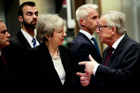 European Commission President Jean-Claude Juncker, right, speaks with British Prime Minister Theresa May prior to a meeting at EU headquarters in Brussels, on Feb. 20, 2019. (AP Photo/Olivier Matthys)