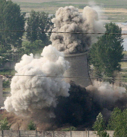 In this June 27, 2008 file photo released by China's Xinhua News Agency, the cooling tower of the Yongbyon nuclear complex is demolished in Yongbyon, North Korea. (Gao Haorong/Xinhua via AP)