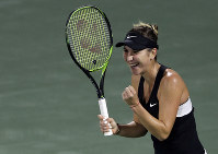 Switzerland's Belinda Bencic celebrates after defeating Romania's Simona Halep in their quarterfinal match of the Dubai Duty Free Tennis Championship in Dubai, United Arab Emirates, on Feb. 21, 2019. (AP Photo/Kamran Jebreili)