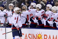 Washington Capitals left wing Alex Ovechkin (8) celebrates his goal with teammates on the bench during second-period NHL hockey game action against the Toronto Maple Leafs in Toronto, on Feb. 21, 2019. (Frank Gunn/The Canadian Press via AP)