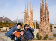 Visitors take a photograph in front of a miniature version of the Sagrada Familia at the Tobu World Square theme park in the city of Nikko, Tochigi Prefecture, north of Tokyo, on Jan. 29, 2019. (Mainichi/Makoto Hananoi)