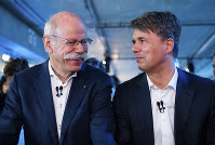 BMW CEO Harald Krueger, right, and Mercedes-Benz CEO Dieter Zetsche of Daimler, left, sit together at a press conference in Berlin, Germany, on Feb. 22, 2019. (Bernd von Jutrczenka/dpa via AP)