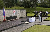 In this Jan. 29, 2016, file photo, Japan's Emperor Akihito and Empress Michiko bow to pay their respects to the Japanese Imperial Forces who died during WWII at the Japanese Memorial Garden at Cavinti, southeast of Manila, Philippines. (AP Photo/Bullit Marquez)