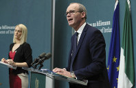 Deputy Prime Minister Simon Coveney, right, and Minister of State for European Affairs Helen McEntee, give a media conference on the publication of the Withdrawal of the United Kingdom from the European Union (Consequential Provisions) Bill 2019, at Government Buildings in Dublin, Ireland, on Feb. 22, 2019. (Brian Lawless/PA via AP)