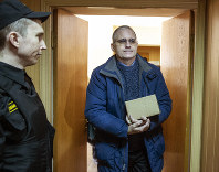 Paul Whelan, a former U.S. Marine, who was arrested in Moscow at the end of last year, arrives for a hearing in a court in Moscow, Russia, on Feb. 22, 2019. (AP Photo/Dmitry Serebryakov)