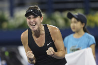 Switzerland's Belinda Bencic celebrates after winning over Ukraine's Elina Svitolina during their women's singles semifinals match of the Dubai Duty Free Tennis Championship in Dubai, United Arab Emirates, on Feb. 22, 2019. (AP Photo/Kamran Jebreili)