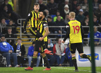 Watford's Gerard Deulofeu, left, celebrates scoring his side's second goal of the game with teammates Troy Deeney and Will Hughes, right, during the English Premier League soccer match between Cardiff City and Watford at the Cardiff City Stadium, Wales, on Feb. 22, 2019. (Simon Galloway/PA via AP)