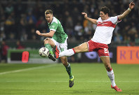 Werder's Niklas Moisander, left, battles against Stuttgart's Mario Gomez for the ball during the German Bundesliga soccer match between Werder Bremen and VfB Stuttgart in Bremen, Germany, on Feb. 22, 2019. (Carmen Jaspersen/dpa via AP)