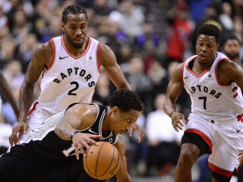 60ce5242d1845 San Antonio Spurs guard DeMar DeRozan (10) loses the ball under pressure  from Toronto Raptors forward Kawhi Leonard (2) with about 15 seconds left  in an NBA ...
