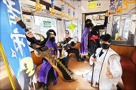 Ninja performers pose for a photograph in a commemorative train on the newly nicknamed
