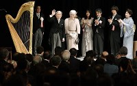 Emperor Akihito and Empress Michiko are applauded during a ceremony marking the 30th anniversary of His Majesty's reign organized by the Japanese government at the National Theatre of Japan in Tokyo's Chiyoda Ward on Feb. 24, 2019. (Pool photo)