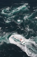 A sightseeing boat is seen near the Naruto whirlpools from a Mainichi Shimbun helicopter on March 2, 2019. (Mainichi/Yohei Koide)