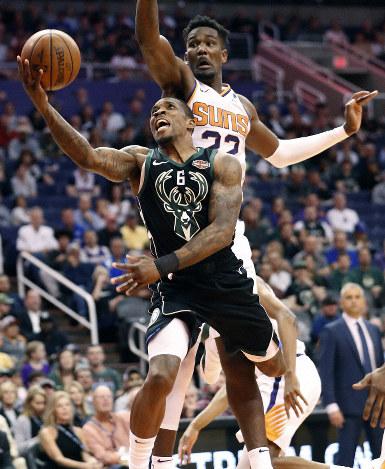 fd4cbc07a24 Milwaukee Bucks guard Eric Bledsoe (6) shoots past Phoenix Suns center  Deandre Ayton (22) during the first half of an NBA basketball game on March  4