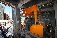 A specialized machine inserts reinforced steel into a hole to build a column at a construction site for the Linear Chuo Shinkansen maglev train's Nagoya Station in Nagoya's Nakamura Ward on March 7, 2019. (Mainichi/Koji Hyodo)