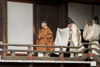 Emperor Akihito makes his way to the Imperial Sanctuary of the Three Palace Sanctuaries to report his abdication and its date, at the Imperial Palace in Tokyo on March 12, 2019. (Photo courtesy of the Imperial Household Agency)