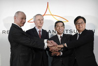 From left, Renault CEO Thierry Bollore, Renault Chairman Jean-Dominique Senard, Nissan CEO Hiroto Saikawa and Mitsubishi Motors Chairman and CEO Osamu Masuko pose for photographers after their joint press conference at Nissan headquarters in Yokohama, on March 12, 2019. (AP Photo/Eugene Hoshiko)