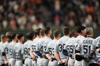 The Seattle Mariners' Ichiro Suzuki, at right wearing No. 51, stands with his teammates for the national anthems of Japan and the United States ahead of an exhibition game versus the Yomiuri Giants at the Tokyo Dome, on March 17, 2019. (Mainichi/Tatsuro Tamaki)