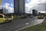 Emergency services attend the scene of a shooting in Utrecht, Netherlands, on Monday March 18, 2019. (Martijn van der Zande via AP)