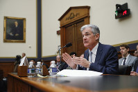 In this Feb. 27, 2019 file photo, Federal Reserve Board Chair Jerome Powell gestures while speaking before the House Committee on Financial Services hearing on Capitol Hill in Washington. (AP Photo/Pablo Martinez Monsivais)