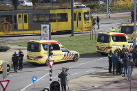 Ambulances are seen next to a tram after a shooting in Utrecht, Netherlands, on March 18, 2019. (AP Photo/Peter Dejong)