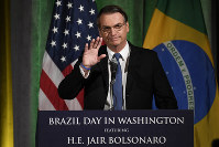 Brazilian President Jair Bolsonaro gestures at the U.S. Chamber of Commerce in Washington, on March 18, 2019. (AP Photo/Susan Walsh)