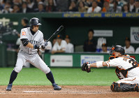 Seattle Mariners' Ichiro Suzuki chases the ball caught by Yomiuri Giants catcher Ginjiro Sumitani while being called out on strikes in the fourth inning of their preseason exhibition baseball game at Tokyo Dome in Tokyo, on March 18, 2019. (AP Photo/Toru Takahashi)