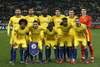 Chelsea starting players pose for a team photo at the beginning of the Europa League round of 16, second leg soccer match between Dynamo Kiev and Chelsea at the Olympiyskiy stadium in Kiev, Ukraine, on March 14, 2019. (AP Photo/Efrem Lukatsky)