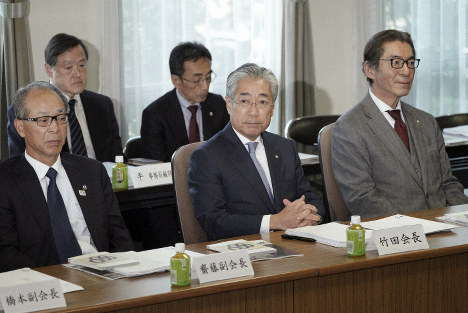 International Olympics Committee member and head of the Japanese Olympic Committee Tsunekazu Takeda, center, attends a JOC executive board meeting in Tokyo, on March 19, 2019. (AP Photo/Eugene Hoshiko)
