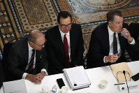 n this Feb. 21, 2019, file photo White House economic adviser Larry Kudlow, left, Treasury Secretary Steve Mnuchin, and U.S. Trade Representative Robert Lighthizer, attend a meeting of senior U.S. and Chinese officials to resume trade negotiations in Washington. (AP Photo/Jacquelyn Martin)