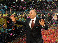 In this Dec. 5, 2005, file photo, Kazakhstan's President Nursultan Nazarbayev waves to supporters after his victory in Sunday's presidential election was officially announced in the capital of Astana. (Presidential Press Service/Pool Photo via AP)