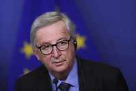 European Commission President Jean-Claude Juncker listens to a question during a joint press conference with Slovakian President Andrej Kiska at the European Commission headquarters in Brussels, on March 19, 2019. (AP Photo/Francisco Seco)