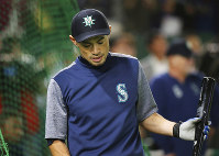Seattle Mariners right fielder Ichiro Suzuki looks down during the team's batting practice prior to Game 2 of the Major League baseball opening series between the Mariners and the Oakland Athletics at Tokyo Dome in Tokyo, Thursday, March 21, 2019. Ichiro is in the starting lineup for the Mariners in what might be his last game in the majors. (AP Photo/Koji Sasahara)