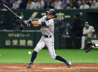 Seattle Mariners' Ichiro Suzuki fouls a ball in the fourth inning of Game 1 of a Major League opening series baseball game against the Oakland Athletics at Tokyo Dome in Tokyo, Wednesday, March 20, 2019. (AP Photo/Toru Takahashi)