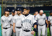 Seattle Mariners right fielder Ichiro Suzuki leaves after his team's group photo prior to Game 1 of a Major League opening series baseball game against the Oakland Athletics at Tokyo Dome in Tokyo, Wednesday, March 20, 2019. (AP Photo/Toru Takahashi)