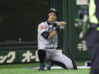 Seattle Mariners' Ichiro Suzuki waits for batting against the Yomiuri Giants in the fourth inning of their preseason exhibition baseball game at Tokyo Dome in Tokyo, Monday, March 18, 2019. (AP Photo/Koji Sasahara)
