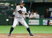 Seattle Mariners right fielder Ichiro Suzuki is called out on strikes against the Yomiuri Giants in the fourth inning of their preseason exhibition baseball game at Tokyo Dome in Tokyo, Monday, March 18, 2019. (AP Photo/Toru Takahashi)