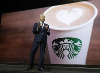 Starbucks CEO Kevin Johnson speaks on March 20, 2019, at the company's annual shareholders meeting in Seattle. (AP Photo/Ted S. Warren)