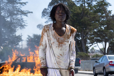This image released by Universal Pictures shows Lupita Nyong'o in a scene from 'Us,' written, produced and directed by Jordan Peele. (Claudette Barius/Universal Pictures via AP)