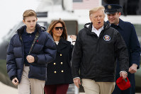 In this March 8, 2019 file photo, President Donald Trump and first lady Melania Trump and their son Barron Trump, walk from Marine One to board Air Force One, on March 8, 2019, in Andrews Air Force Base, Md. (AP Photo/Carolyn Kaster)