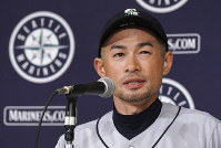 Seattle Mariners right fielder Ichiro Suzuki announces his retirement during a press conference after Game 2 of the Major League baseball opening series between the Mariners and the Oakland Athletics in Tokyo Thursday, March 21, 2019. (AP Photo/Eugene Hoshiko)